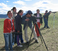 Students and researchers in Erdenebulgan Sum, Mongolia observe Great Bustards